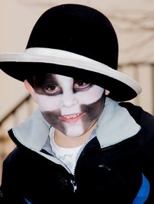 Boy's face painted with Cornish flag