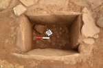 Beaker lying on cobbled floor of cist. Picture AOC Archaeology